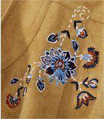 Bunda zumělého semiše zdobená výšivkami
