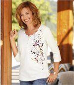 T-shirt met bloemenmotief en knopenhals preview1