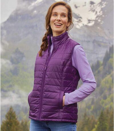 Prošívaná vesta švestkové barvy